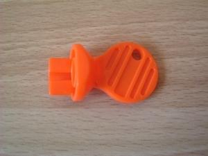 Clé orange pour rocher