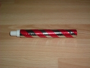 Cotillons  tube lance boules rouge neuf