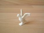 Pigeon blanc ailes déployées