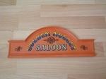 Enseigne saloon ocre