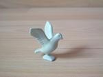 Pigeon gris ailes déployées