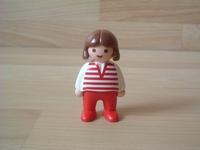Fille pantalon rouge